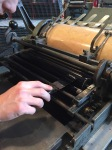 Placing the ink on the roller. You have to be careful not to put too much ink, and also to make sure the ink is evenly distributed.